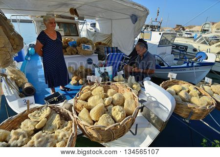 CHANIA GREECE - AUGUST 12: Unknown people sell natural sponges in Chania Crete Greece on 12 August 2014. Chania is one of the most popular tourist place on Crete island in Greece.