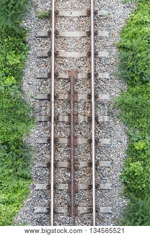 railway top view with stone and green plant beside railway abstract background
