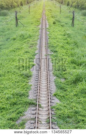 railway top view with stone and green plant beside railway sunlight above abstract background