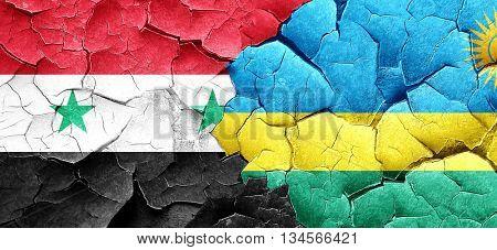 Syria flag with rwanda flag on a grunge cracked wall