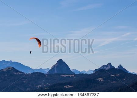 Paragliding in the mountains and blue sky