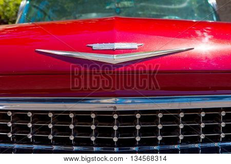 Tel Aviv, Israel, June 12, 2016: 1970's red Cadillac emblem and front grill. Cadillac is a division of General Motors that markets luxury vehicles worldwide.