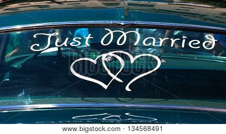 Just married sign on a car's back window.
