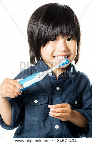 Close up face shot little asian boy brushing teeth with electric toothbrush.Isolated on white background.