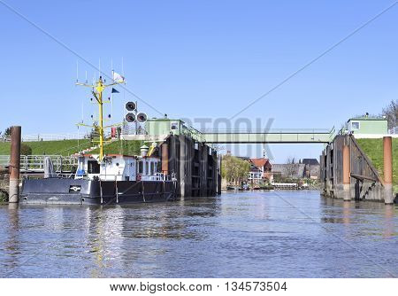 Steel drawbridge from water perspective. Shipping scene.