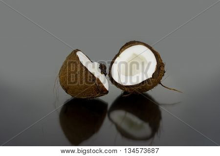 coconut on glass background with reflection close up