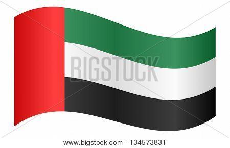 Flag of the United Arab Emirates waving on white background
