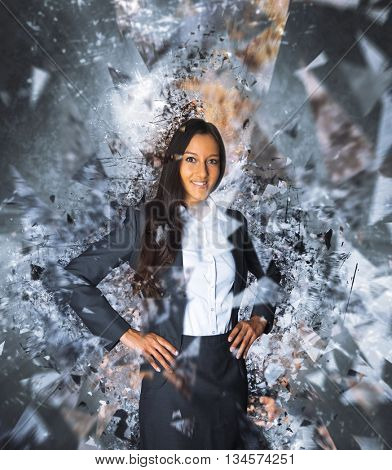 Single young smiling Indian business woman with confident expression and hands on hips surrounded by powerful exploding effect