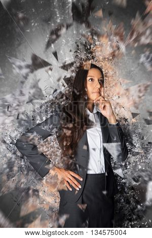 Conceptual rendering of woman with explosive ideas dressed in business attire and surrounded by shards of glass