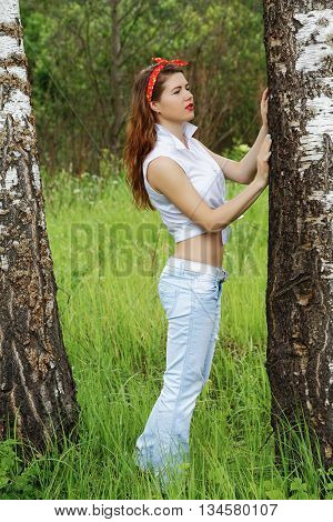 Girl resting in the foliar forest summer