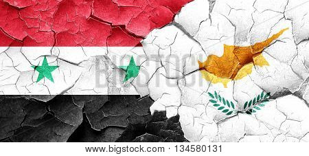Syria flag with Cyprus flag on a grunge cracked wall