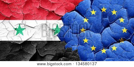 Syria flag with european union flag on a grunge cracked wall