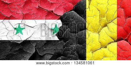 Syria flag with Belgium flag on a grunge cracked wall