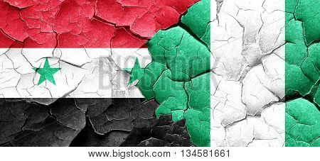 Syria flag with Nigeria flag on a grunge cracked wall