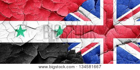 Syria flag with Great Britain flag on a grunge cracked wall