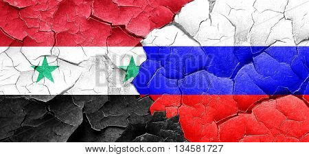 Syria flag with Russia flag on a grunge cracked wall
