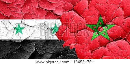 Syria flag with Morocco flag on a grunge cracked wall