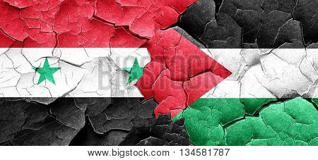 Syria flag with Palestine flag on a grunge cracked wall