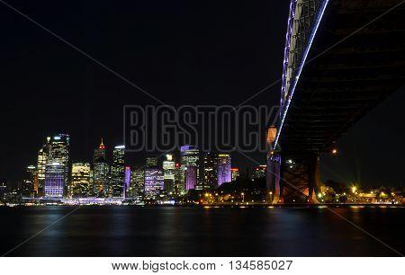 Sydney, AUSTRALIA - Jun 15, 2016. Sydney Harbour Bridge illuminated with colourful light design imagery during the Vivid Sydney 2016 annual public event.