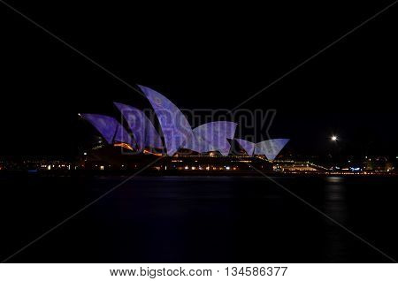 Sydney, AUSTRALIA -  Jun 15, 2016. Sydney Opera House illuminated with colourful light design imagery during the Vivid Sydney 2016 annual public event.