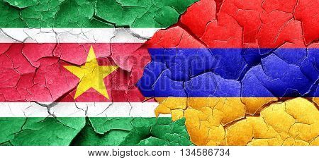 Suriname flag with Armenia flag on a grunge cracked wall