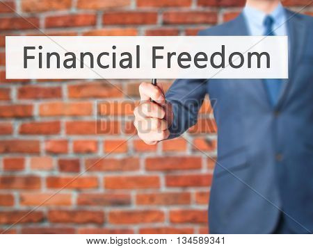 Financial Freedom - Businessman Hand Holding Sign