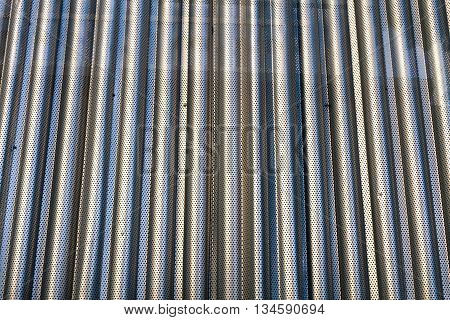 Steel sheet perforated and wavy with reflection