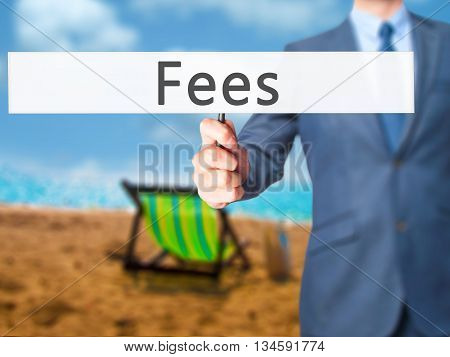 Fees - Businessman Hand Holding Sign