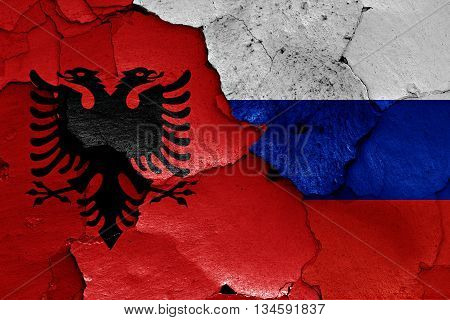 Flags Of Albania And Russia Painted On Cracked Wall