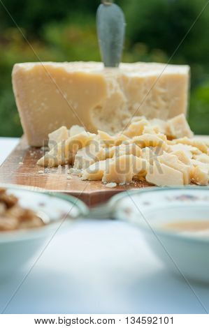 particular of slices of grana cheese during a wedding party