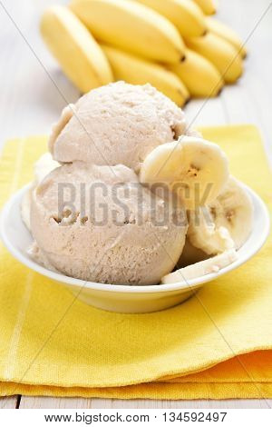 Banana ice cream decorated with slices in bowl