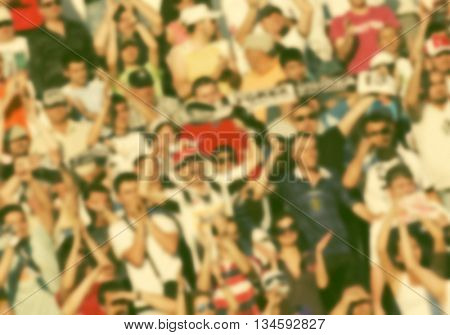 crowd of soccer fans at the stadium - defocused background - football conceppt