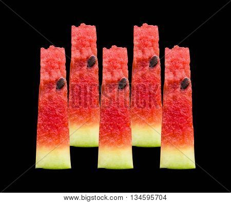 Watermelon pattern isolated on a black background, the view from the front.