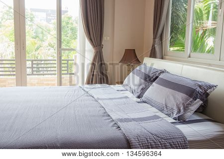 Close up of big comfortable double bed in modern bedroom
