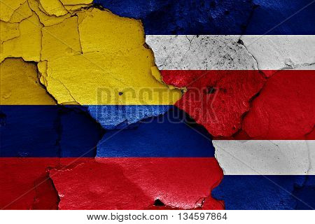 Flags Of Colombia And Costa Rica Painted On Cracked Wall