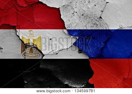 Flags Of Egypt And Russia Painted On Cracked Wall