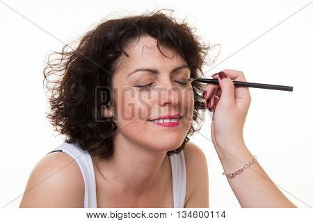 Make-up Artist Applying Eyeshadow On Model's Face