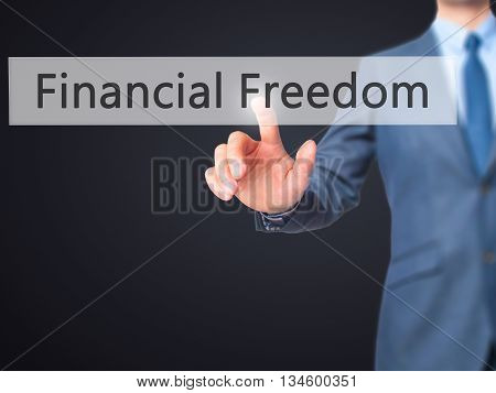Financial Freedom - Businessman Hand Pressing Button On Touch Screen Interface.