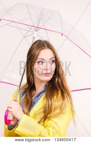 Woman Wearing Waterproof Coat Holding Umbrella
