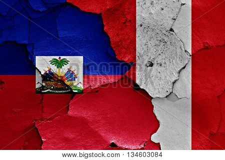 Flags Of Haiti And Peru Painted On Brick Wall