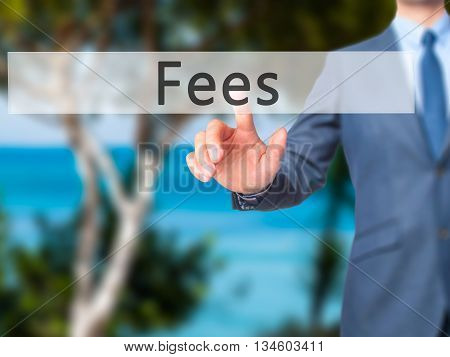 Fees - Businessman Hand Pressing Button On Touch Screen Interface.