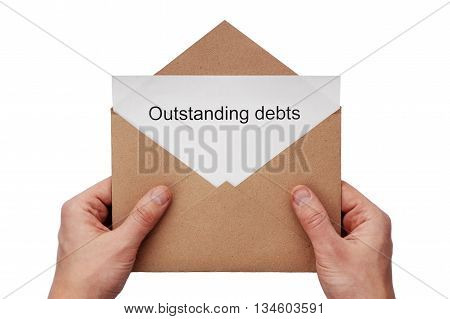 A hand hold a craft envelope with message about outstanding debts, isolated white at the studio