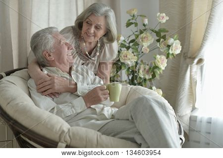 happy Senior couple resting at home with tea cup