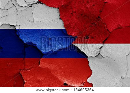 Flags Of Russia  And Indonesia Painted On Cracked Wall