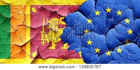 Sri lanka flag with european union flag on a grunge cracked wall