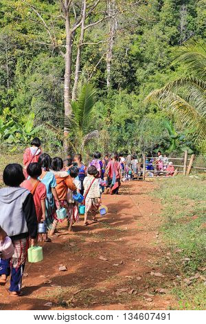 Tak Thailand-Jan 15: Karen children back home after class from border primary scool on Jan 15 2015 in Tha Song Yang Tak Thailand. The School located in mountain near Thailand-Myanmar border for help and teach Ethnics children