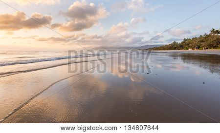 Sunrise reflection at Four Mile Beach at Port Douglas, Queensland, Australia.