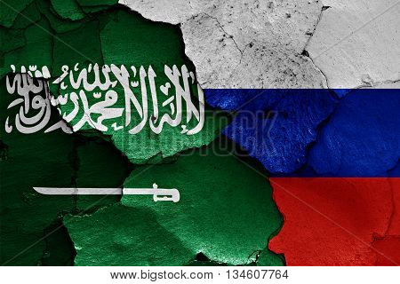 Flags Of Saudi Arabia And Russia Painted On Cracked Wall
