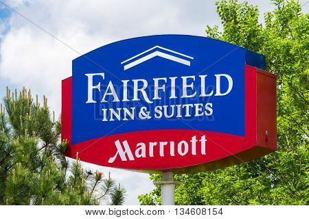 Faifield Inn And Suites Sign And Logo