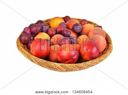 Fruits in wattled basket isolated on a white background